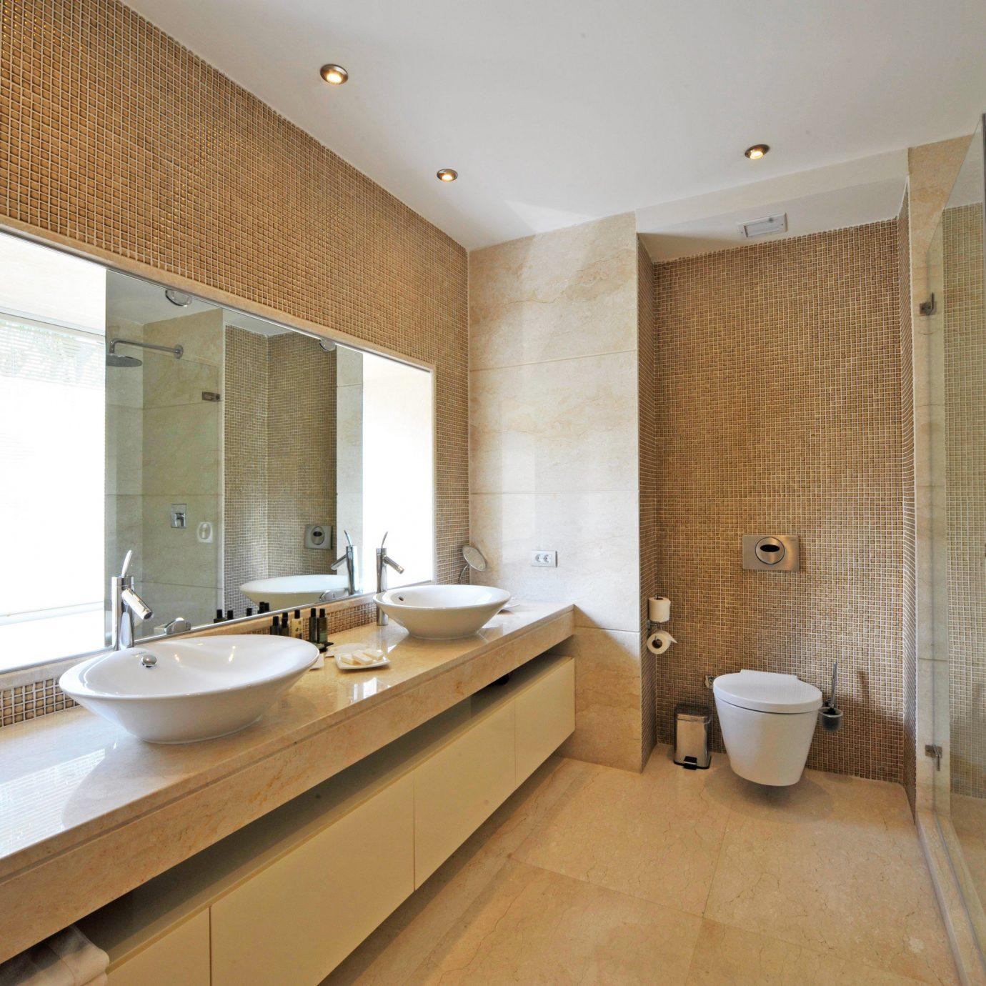 Bath Beach Modern bathroom property sink Suite tub tiled bathtub tile tan