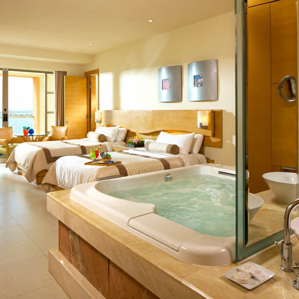 Bath Beachfront Bedroom Elegant Luxury Modern Scenic views Suite property swimming pool home condominium Villa cottage tub