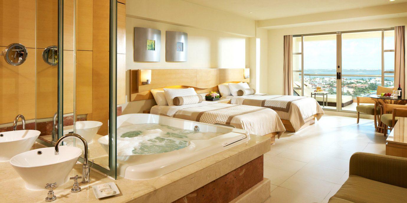 Bath Beachfront Bedroom Elegant Luxury Modern Scenic views Suite property home living room condominium cottage Villa