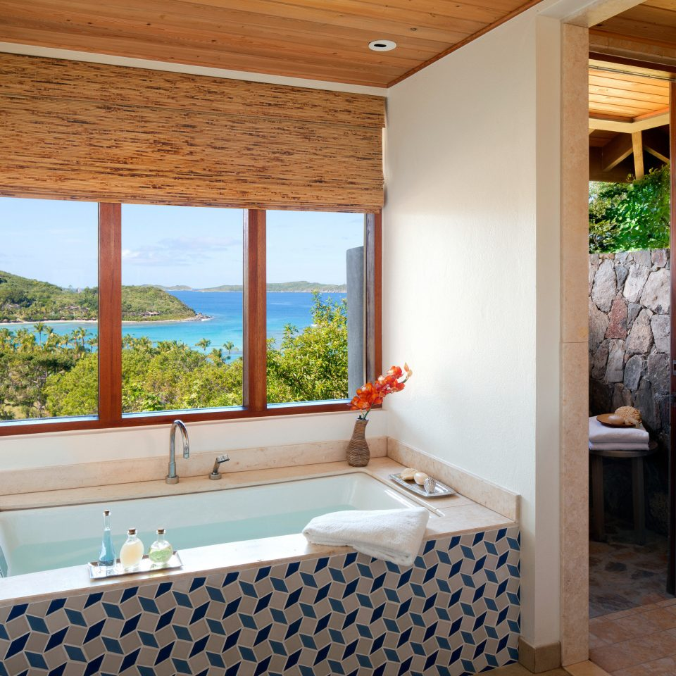 Bath Beachfront Elegant Island Outdoors Patio Resort Romantic Scenic views Waterfront property bathroom home Suite cottage Villa tiled
