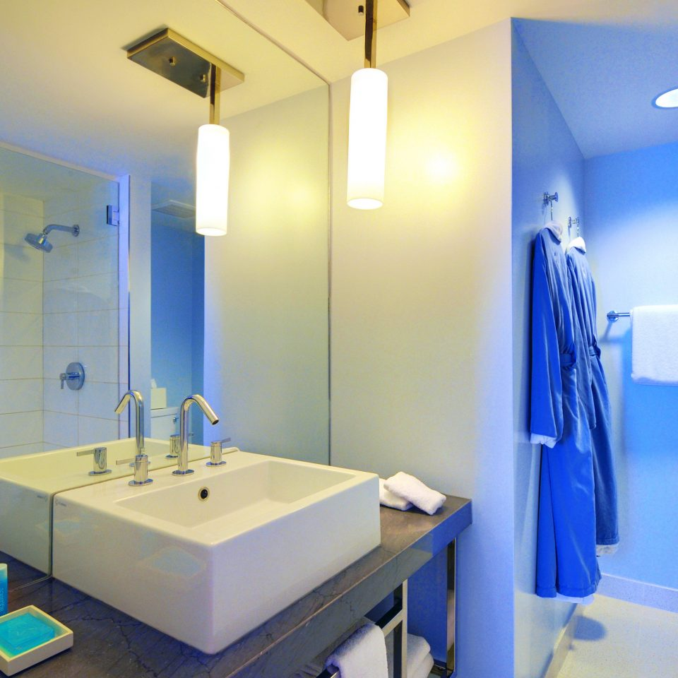 Bath Beachfront Resort bathroom property sink blue public toilet toilet Suite plumbing fixture