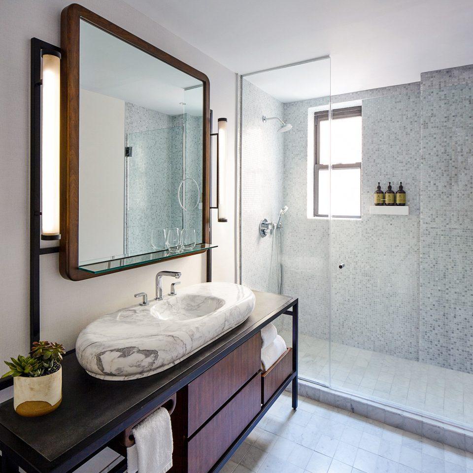 bathroom bathroom accessory sink home bathroom cabinet plumbing fixture interior designer Bedroom tub Bath tiled