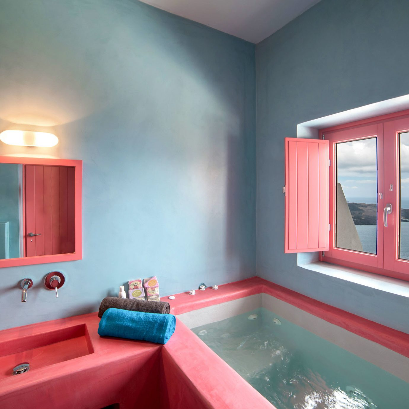 Bath Boutique Suite Waterfront bathroom sink red property pink house painted swimming pool bright home Bedroom living room light cottage colored