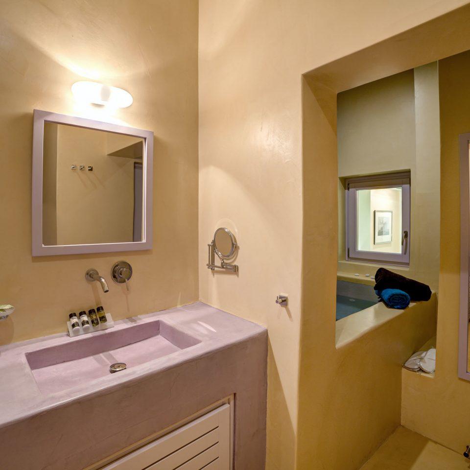 Bath Bedroom Boutique bathroom mirror sink property home Suite cottage tan