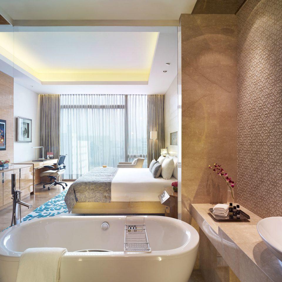 Bath Bedroom Elegant Modern Suite bathroom sink toilet property swimming pool tub home bathtub