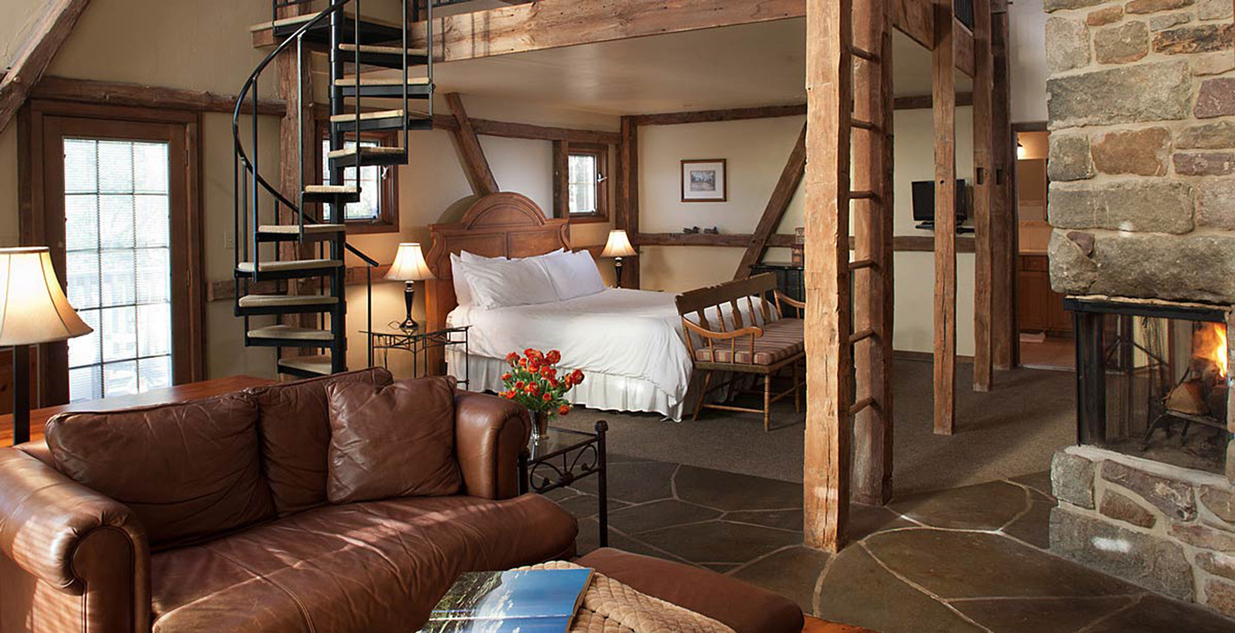 Bath Bedroom Fireplace Inn Rustic sofa living room property home house cottage farmhouse loft log cabin leather