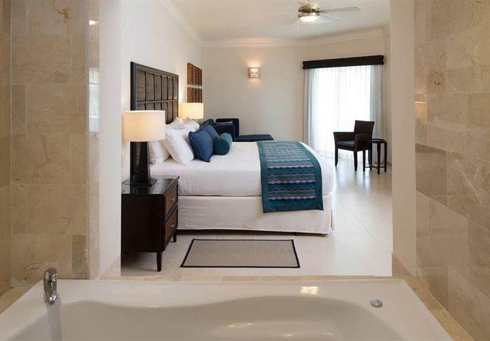 Bedroom Lounge Luxury Suite bathroom property toilet home white sink flooring cottage tub bathtub Bath tiled