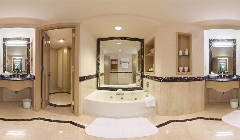 bathroom mirror property home sink mansion lighting Suite cabinetry Bedroom tan fancy Bath