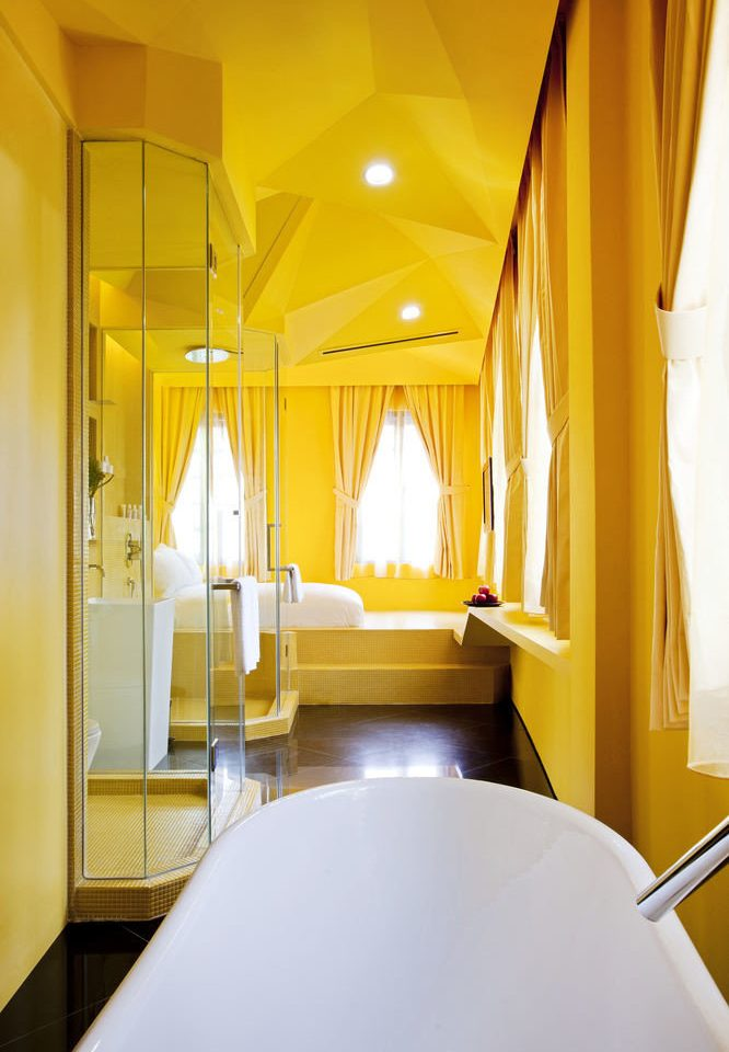 bathroom yellow tub Suite bathtub sink Bedroom Bath
