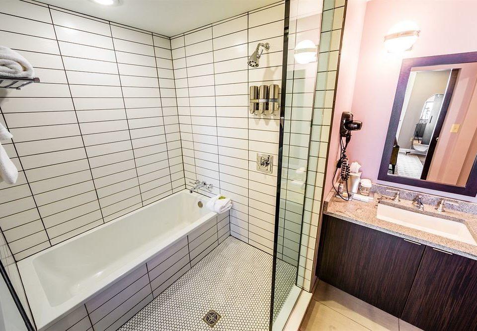 Bath Boutique bathroom property plumbing fixture bathtub tiled