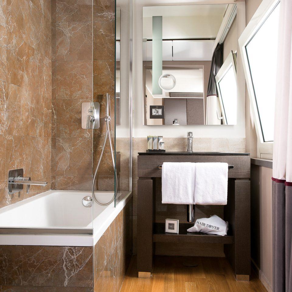 Bath Boutique Budget City Modern bathroom property home cottage Suite flooring tub bathtub tile tiled