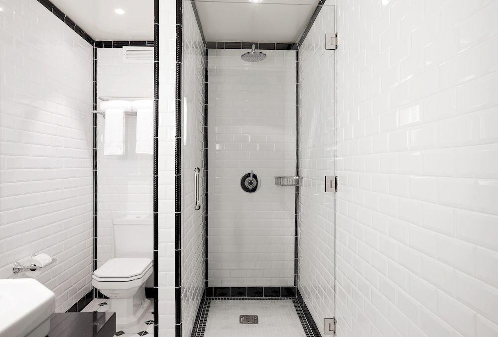 Bath Boutique Budget Hip Modern bathroom white toilet plumbing fixture public toilet sink stall tile tiled