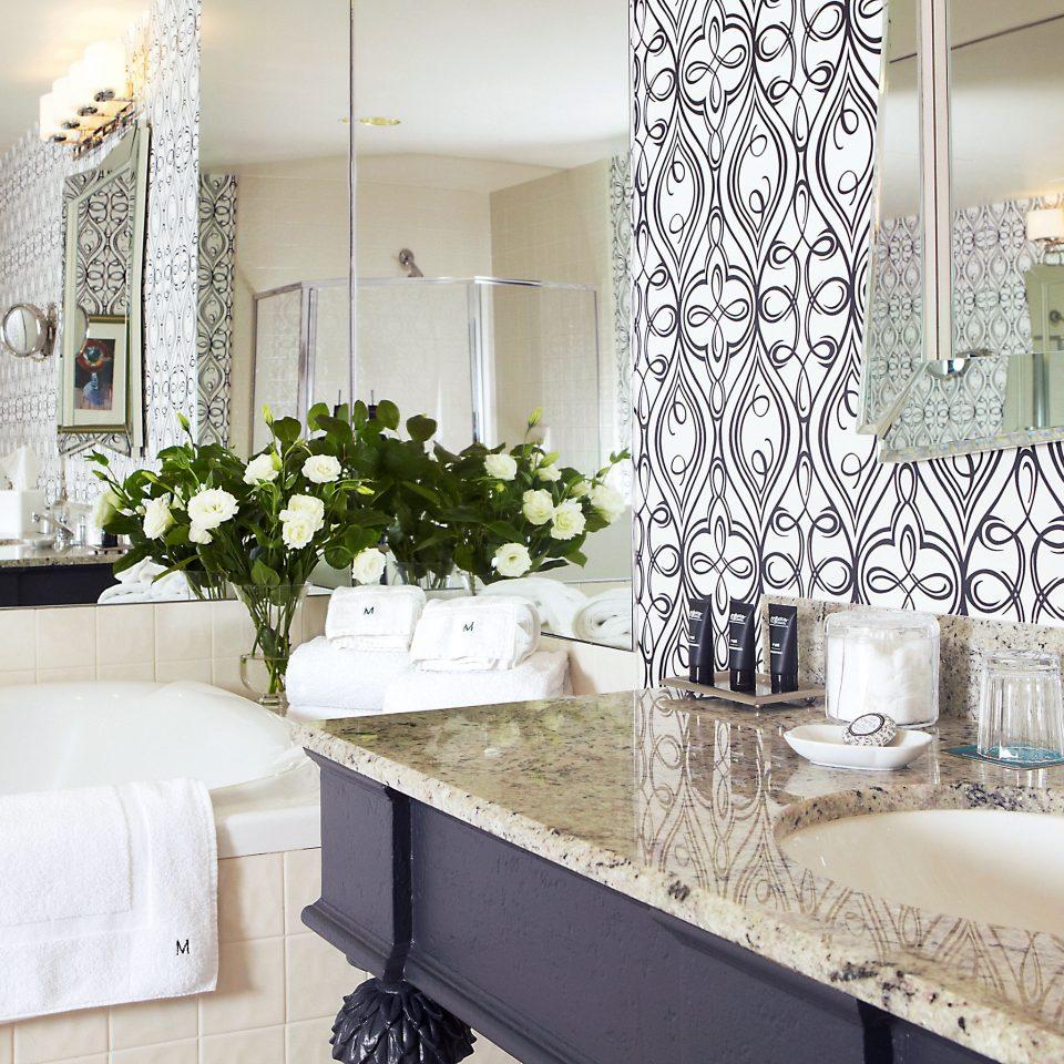 Bath Boutique City Cultural Hip bathroom sink property mirror home living room flooring condominium countertop tub bathtub
