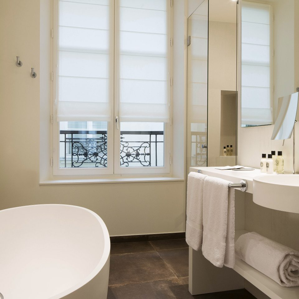 Bath Boutique City Elegant Historic Romance Suite bathroom mirror sink property tub home plumbing fixture bathtub bidet tile tan