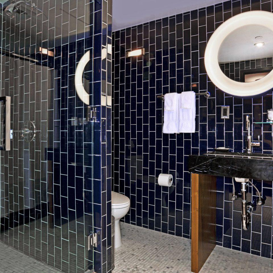 Bath Boutique City Modern black lighting plumbing fixture tiled bathroom flooring tile
