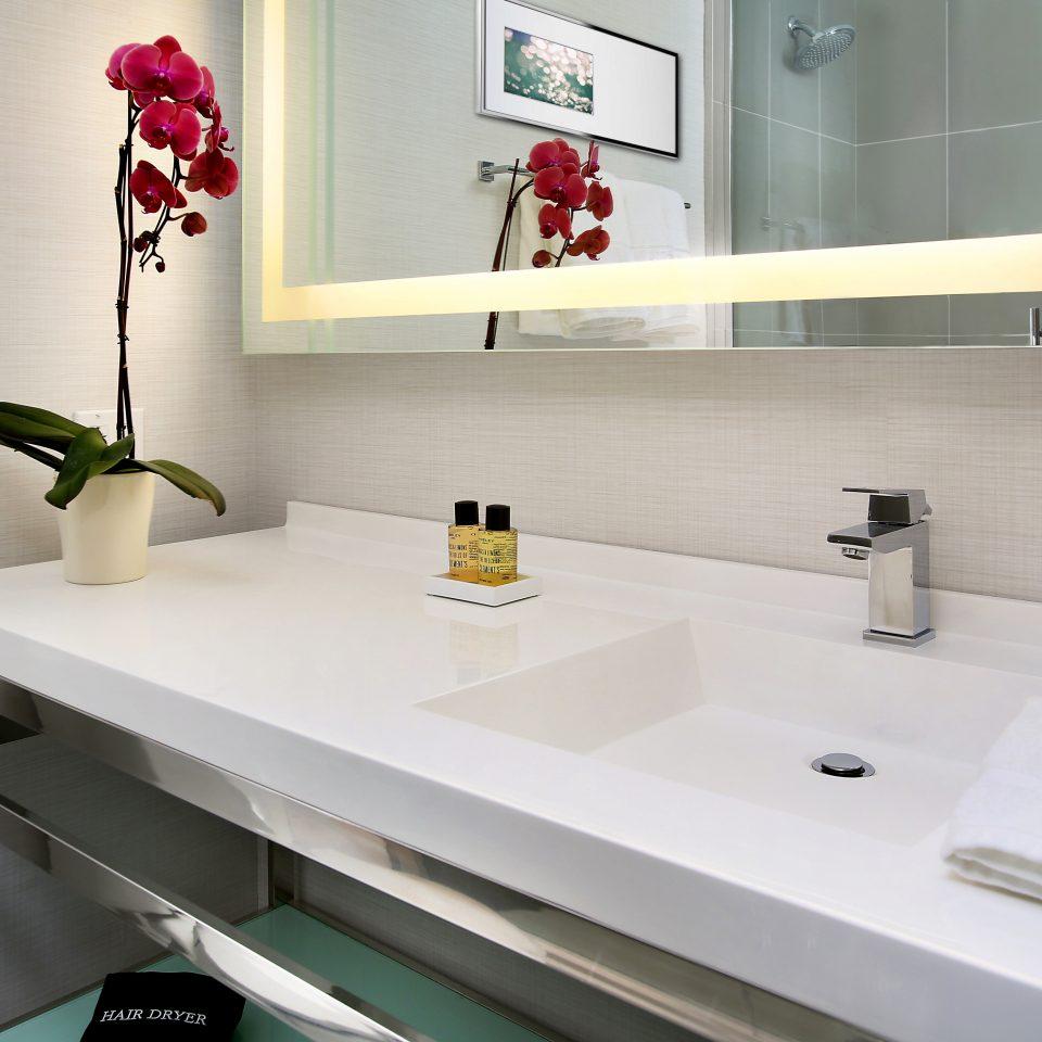 Bath Boutique City Modern bathroom sink mirror counter countertop white plumbing fixture flooring bathtub bidet water basin