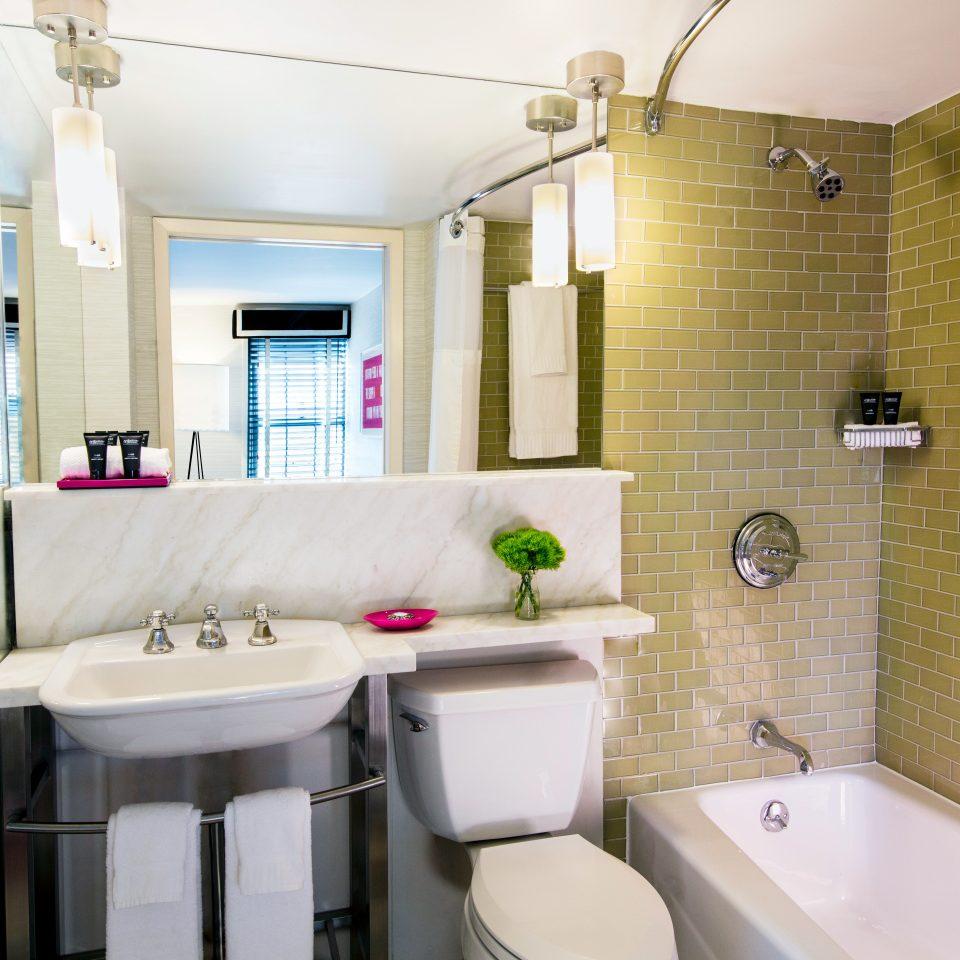 Bath Boutique City Modern bathroom sink property mirror toilet white home cottage Suite rack tile tan