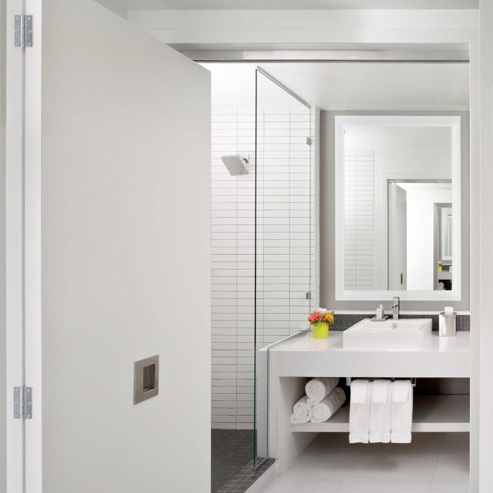Bath Boutique City Modern bathroom white plumbing fixture bathroom cabinet door sink cabinetry flooring