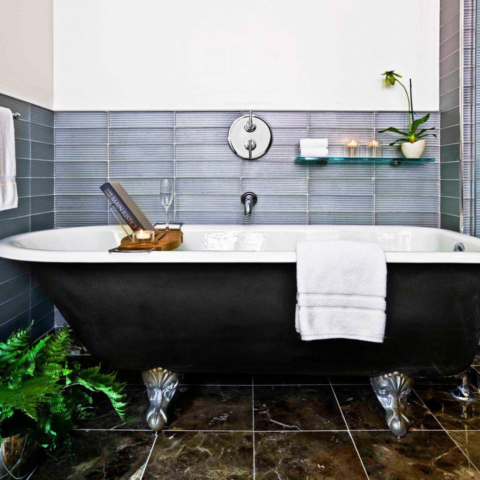 Bath Boutique City Modern bathtub swimming pool bathroom countertop plumbing fixture sink flooring tile