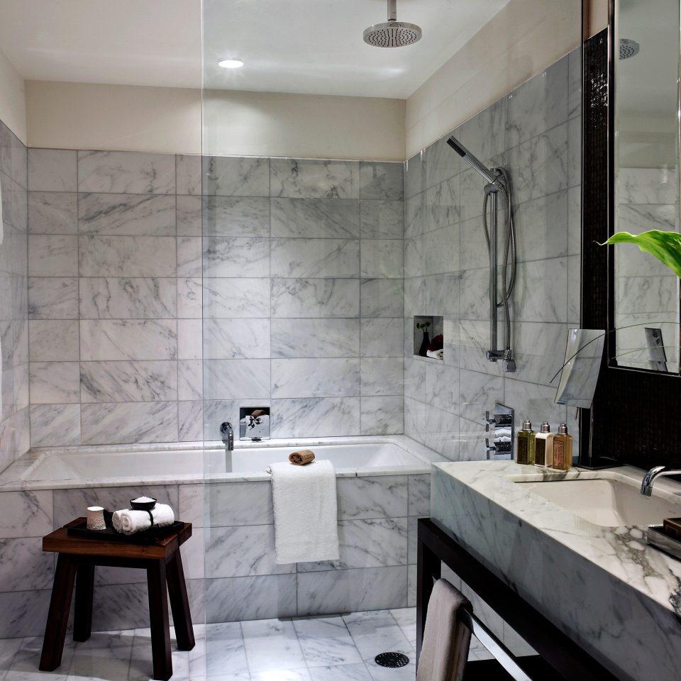 Bath Boutique City Modern bathroom property home tile flooring plumbing fixture