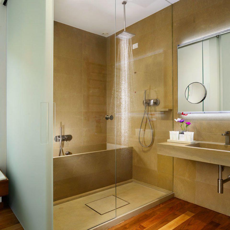 Bath Boutique City Modern bathroom property sink home cabinetry cottage Suite