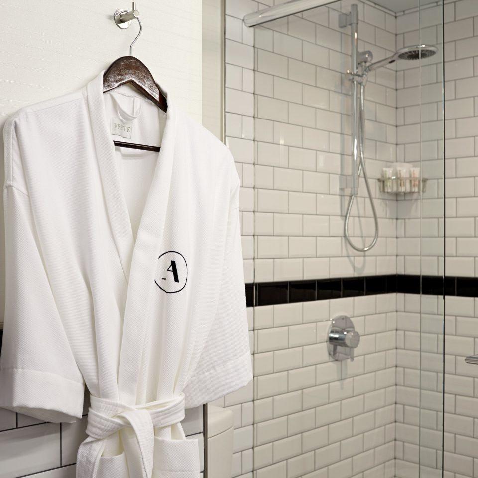 Bath Boutique City Modern bathroom white clothing toilet outerwear plumbing fixture tile tiled