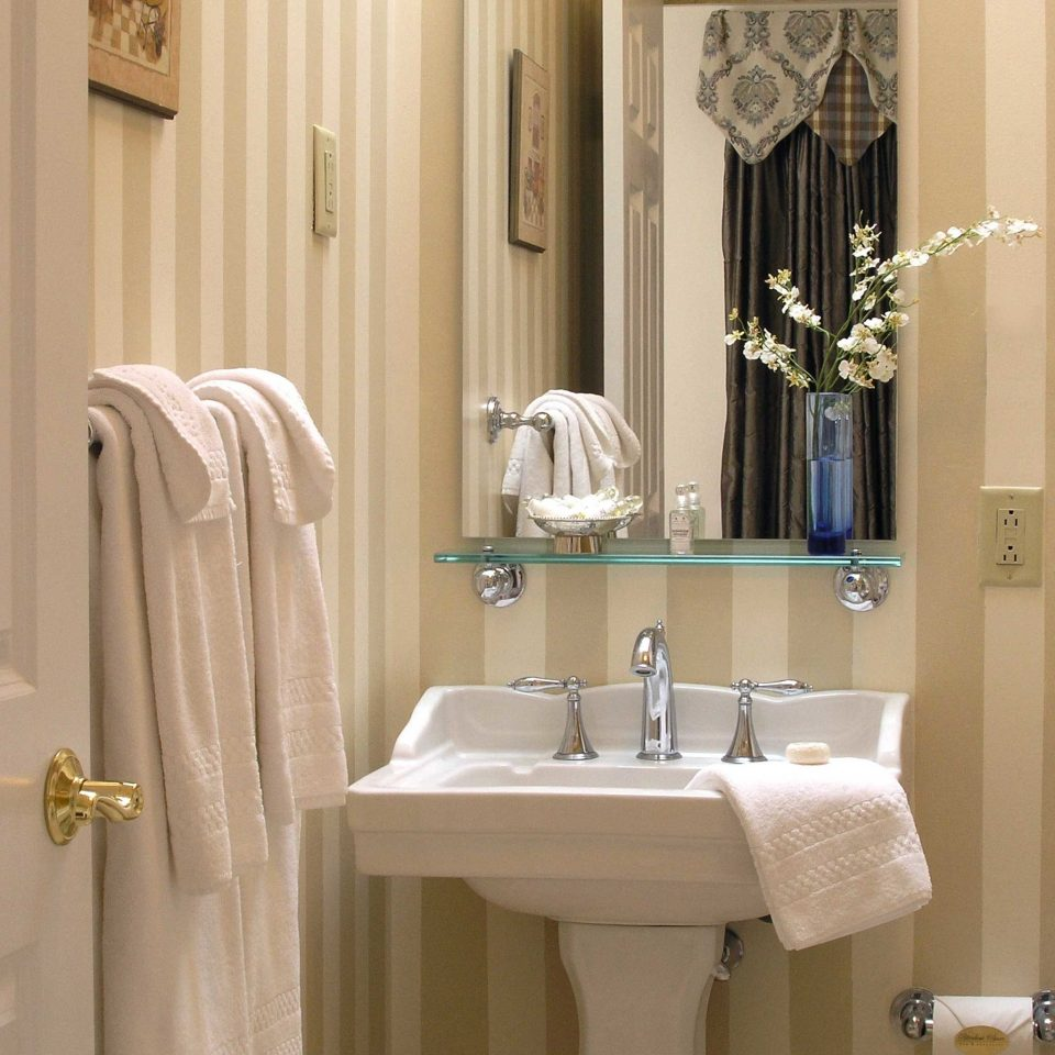 Bath Boutique Classic Elegant Historic Inn bathroom towel mirror sink curtain white plumbing fixture bathroom cabinet textile toilet rack