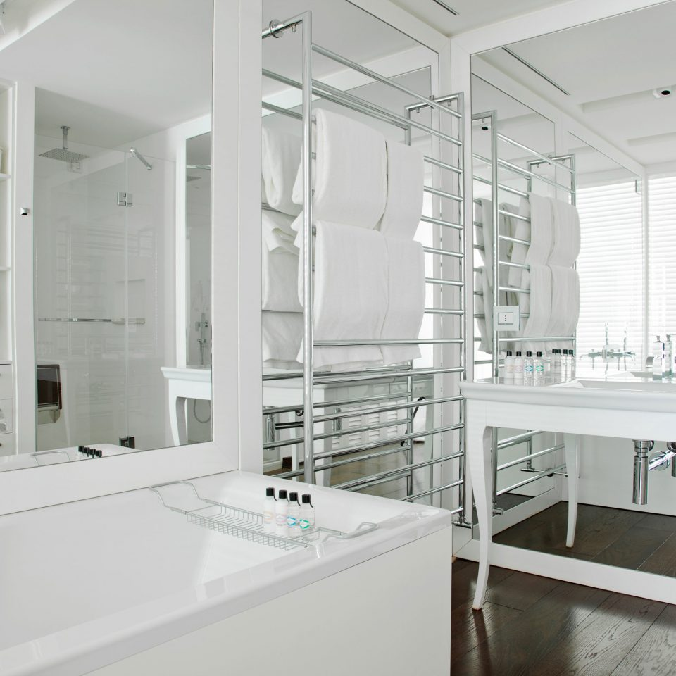 Bath Boutique Hip Modern property white home bathroom office glass loft