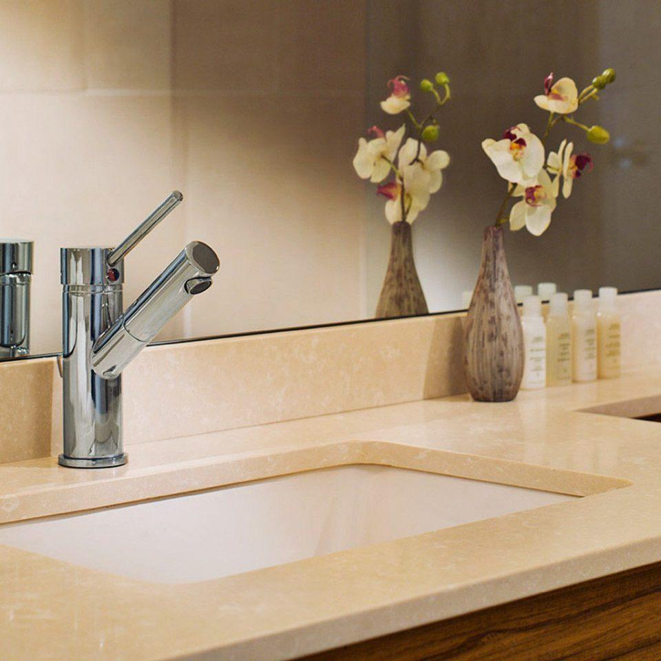 Bath Boutique Inn sink countertop shelf hardwood plumbing fixture flooring tap bathroom