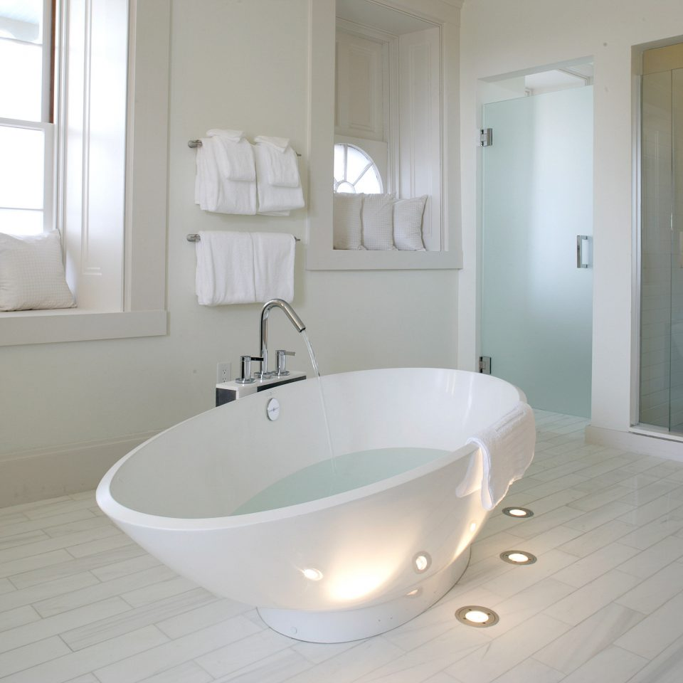 Bath Boutique Inn Luxury bathroom property bathtub sink bidet plumbing fixture flooring tub tan