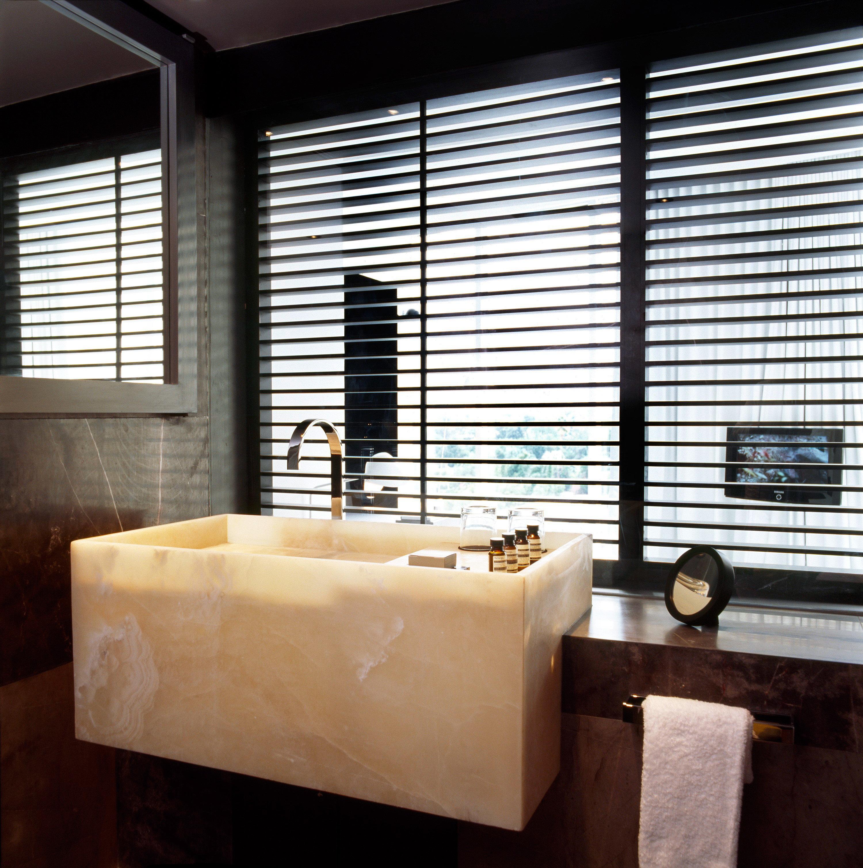 Bath Boutique Modern building window blind bathroom lighting plumbing fixture window treatment sink bathtub tub tan