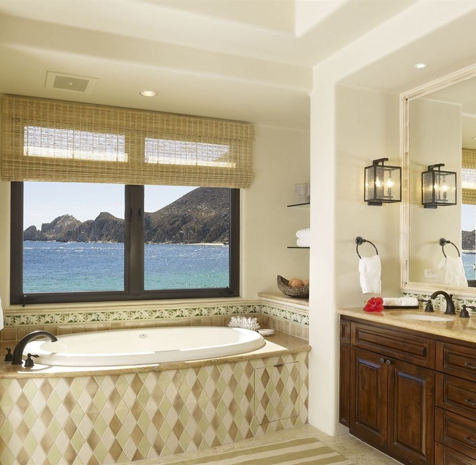 Bath Boutique Modern Tropical bathroom property cabinetry home flooring Suite