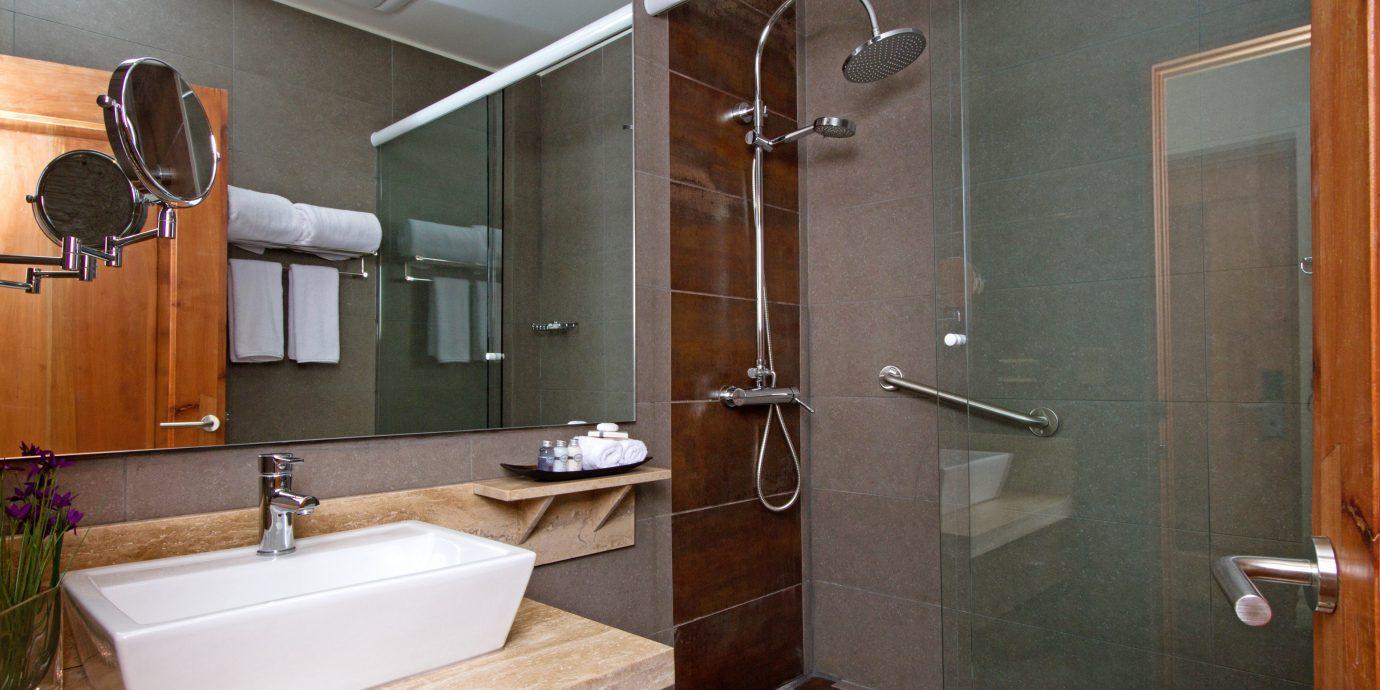 Bath Boutique Modern bathroom property sink toilet home plumbing fixture Suite cottage tile tiled