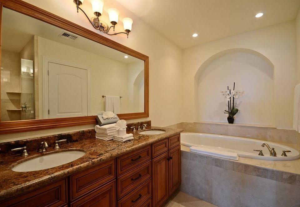 Bath Boutique Modern Waterfront cabinet bathroom mirror sink property home counter cuisine classique vanity cottage cabinetry Suite clean tan tile