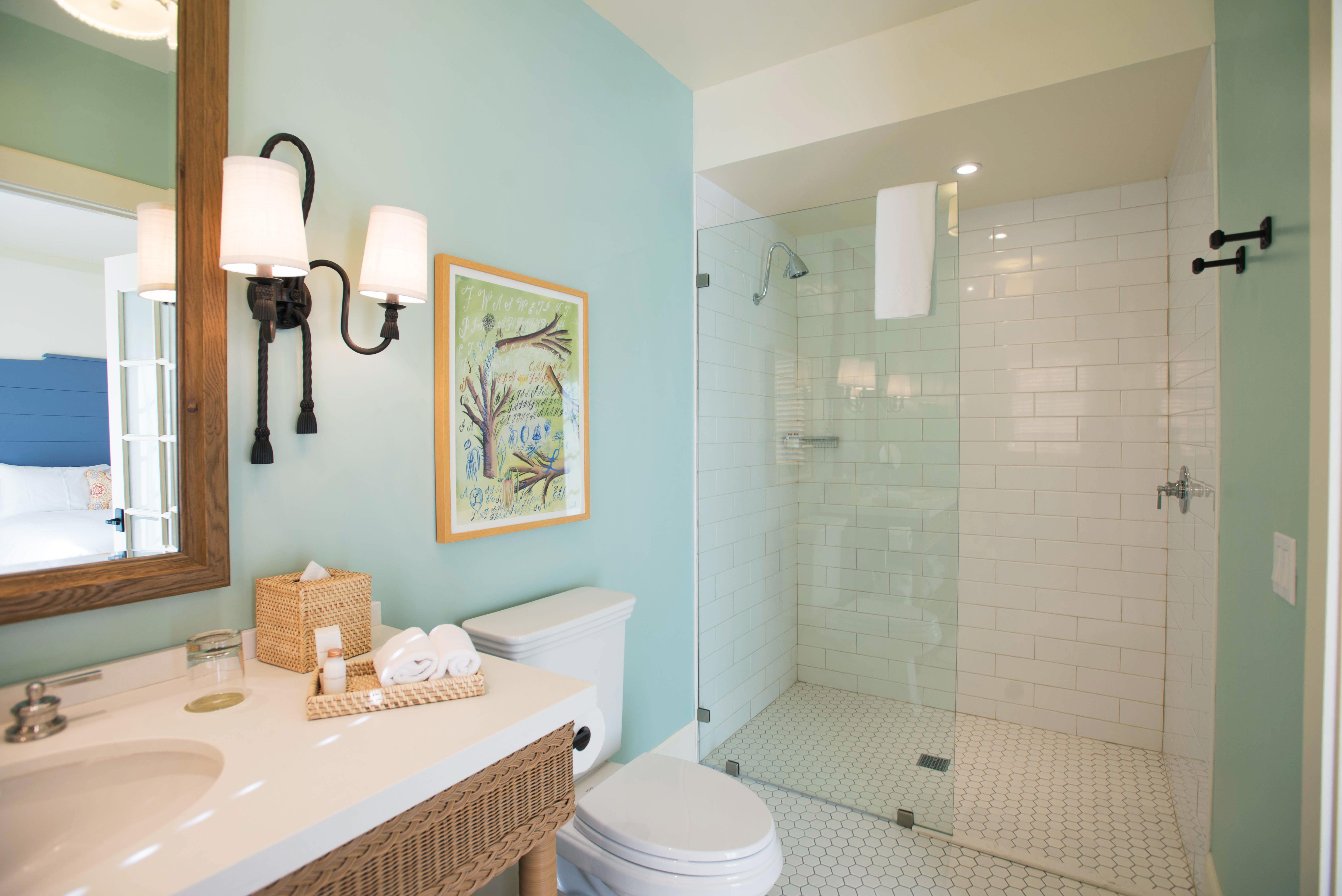 Bath Boutique Natural wonders Romance Wellness bathroom sink mirror property home toilet Suite plumbing fixture tub tile