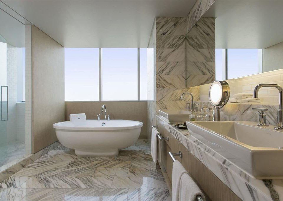 Bath Budget Business Modern bathroom property sink mirror tub home bathtub flooring Suite tan tiled