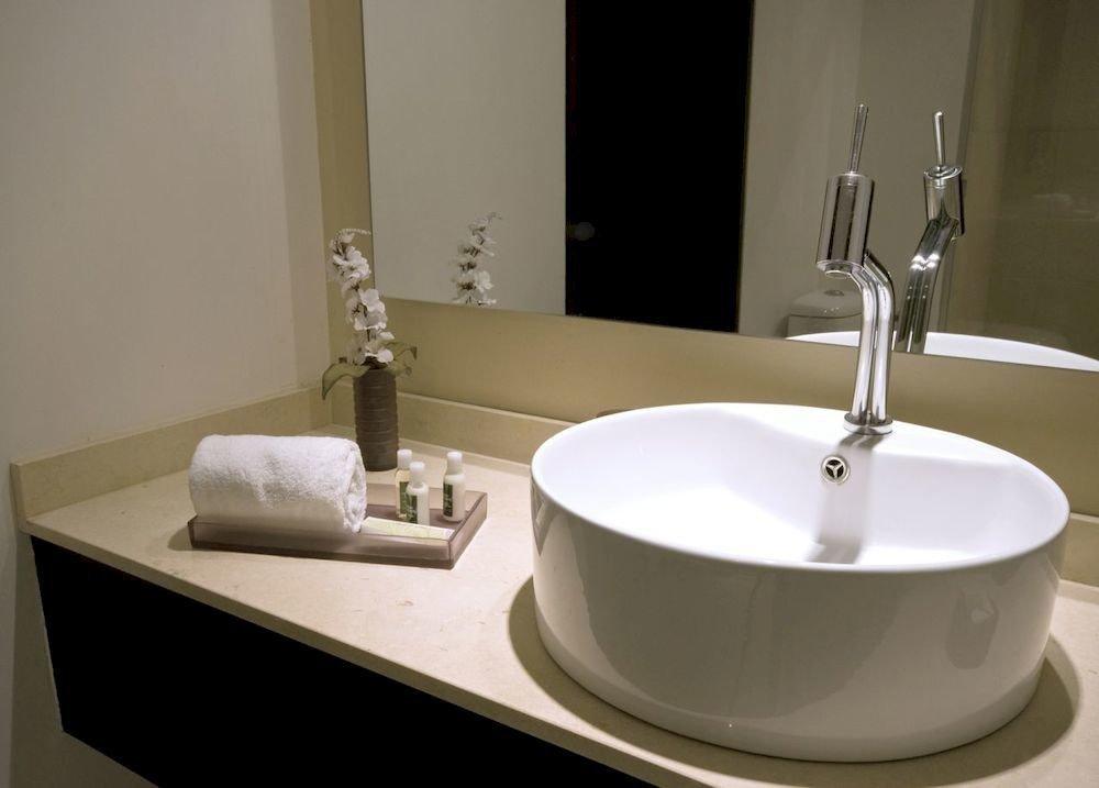 Bath Budget Modern bathroom mirror sink bathtub plumbing fixture bidet ceramic flooring tap counter dining table