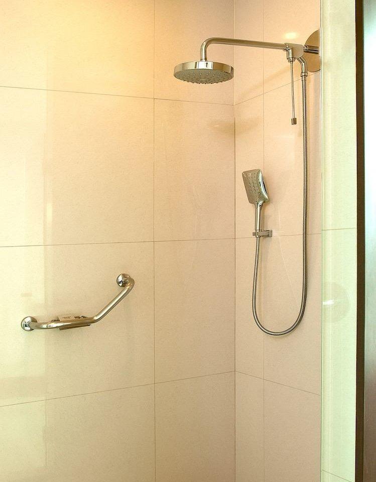 Bath Budget Modern bathroom scene plumbing fixture shower tiled