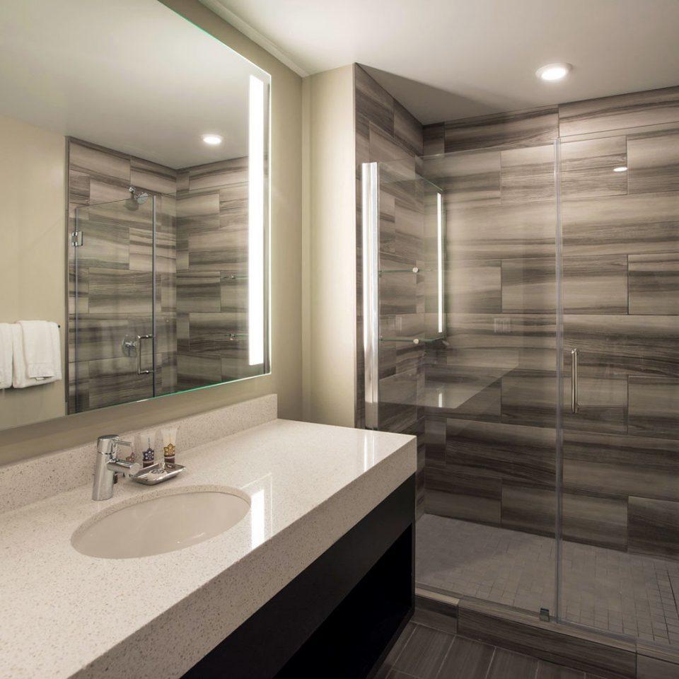 Bath Business bathroom mirror sink property home flooring clean tub