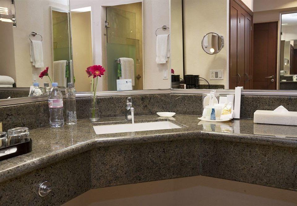 Bath Business Modern bathroom mirror sink property countertop counter home hardwood flooring Kitchen Suite material tile