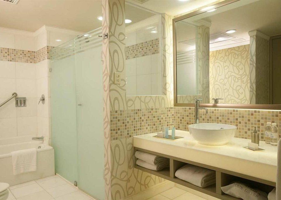 Bath Business Modern bathroom mirror property sink tile Suite tub plumbing fixture flooring bathtub tiled