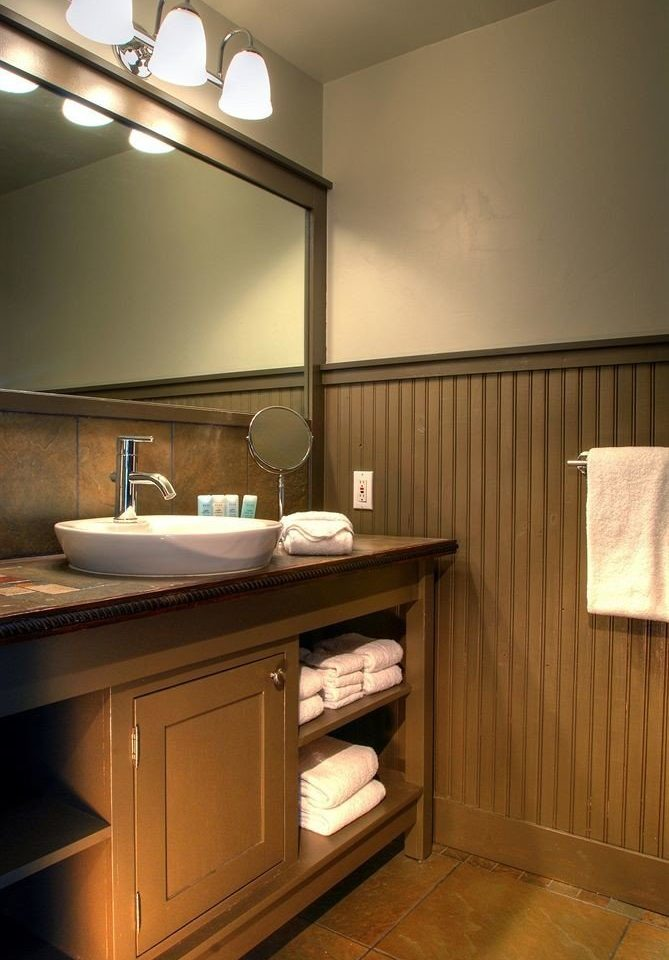 Bath Cabin Classic bathroom sink mirror property Kitchen cabinetry house home hardwood lighting cottage counter