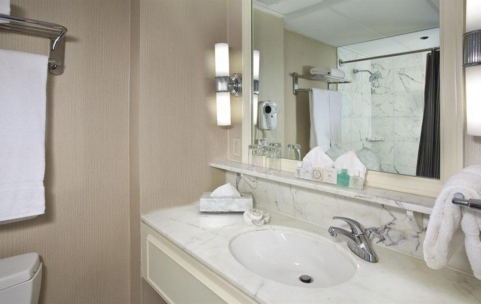 Bath City bathroom sink mirror property toilet towel home cottage vanity bidet rack tub bathtub tan
