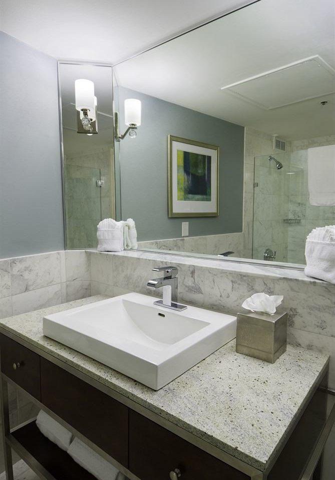 Bath City bathroom mirror sink property countertop long home plumbing fixture counter vessel flooring clean tan