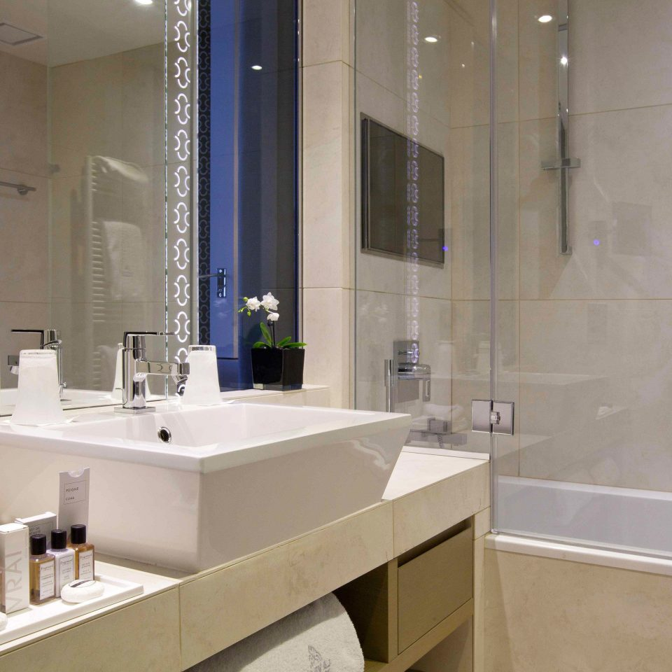 Bath City Hip Modern bathroom sink mirror property home counter toilet flooring plumbing fixture clean tile bathtub tub tiled