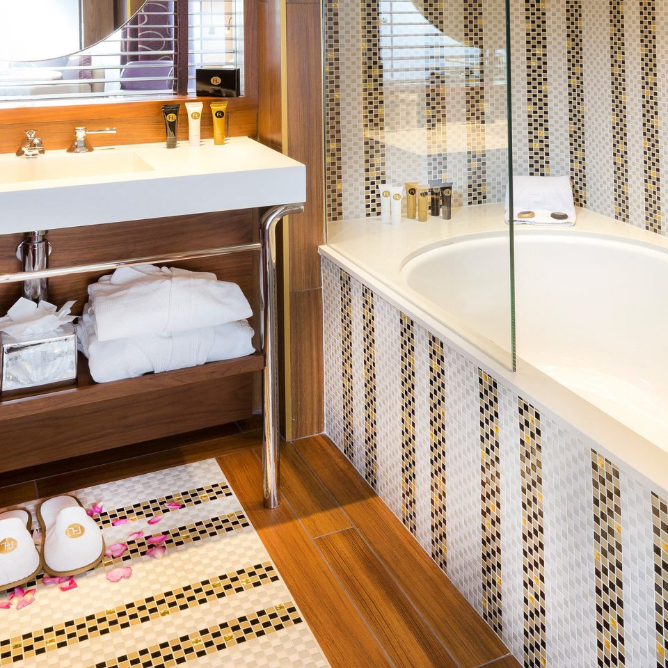 Bath City Hip bathroom bathtub sink flooring home Suite plumbing fixture swimming pool tub tiled
