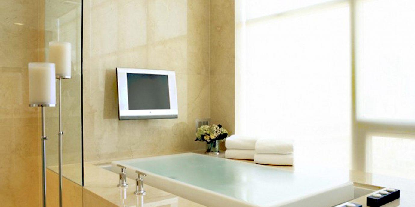 Bath City Hot tub/Jacuzzi sink lighting living room flooring plumbing fixture tile bathroom