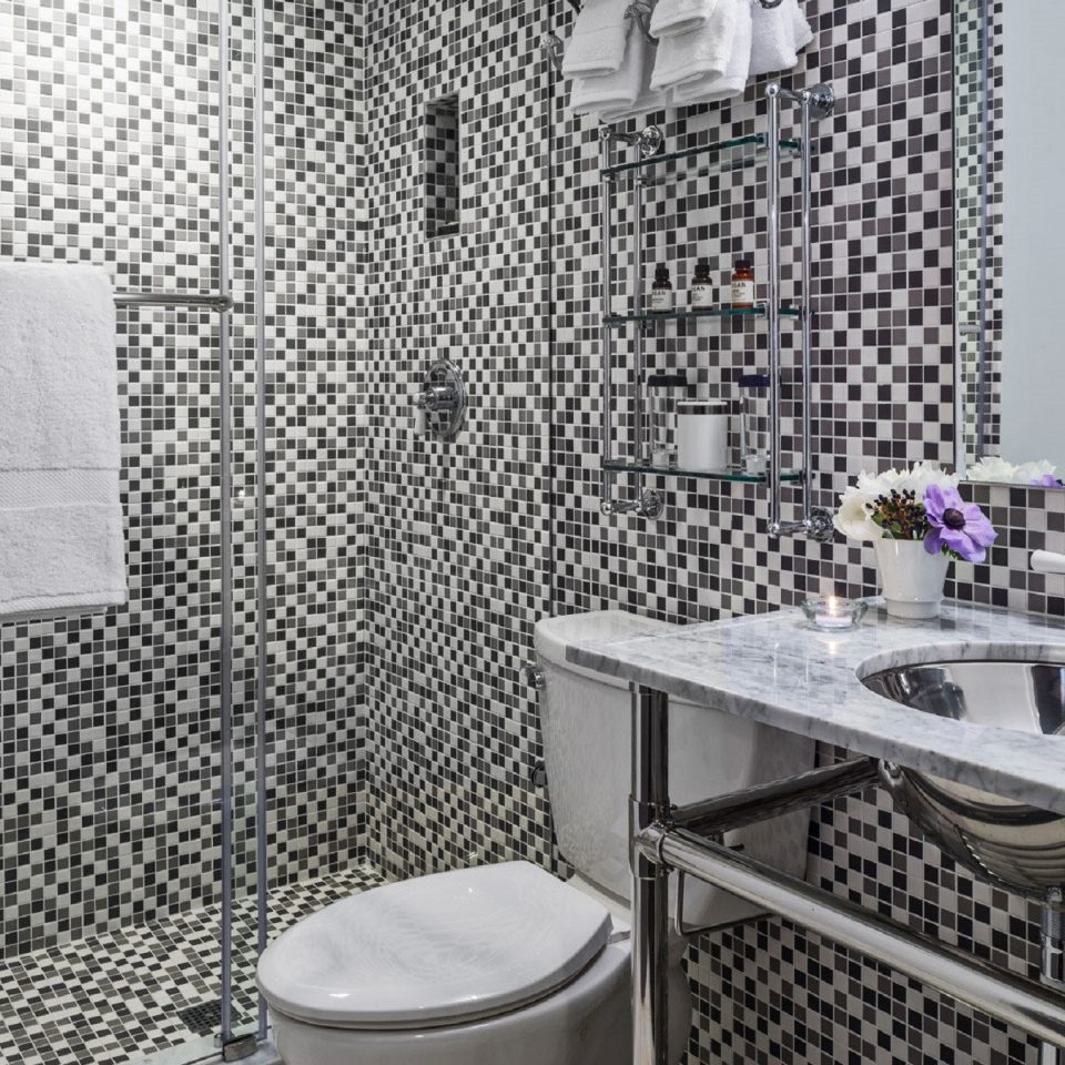 Bath City Luxury bathroom toilet tiled sink tile flooring shower plumbing fixture tub bathtub dining table