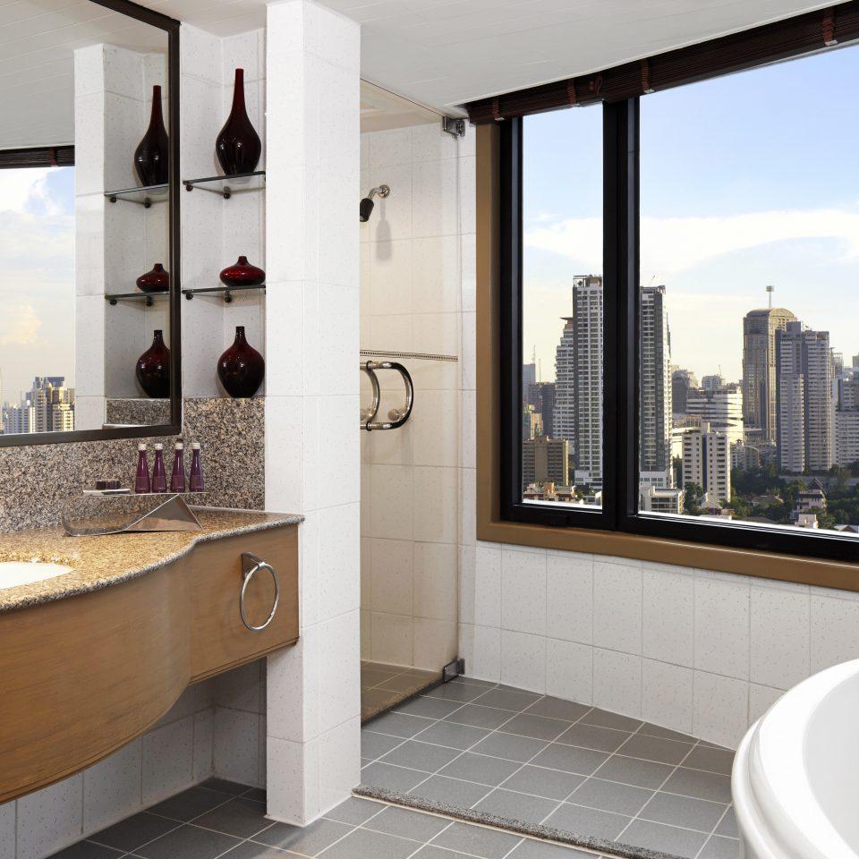Bath City Luxury Scenic views bathroom property home sink bathtub Suite vessel Modern tub tiled
