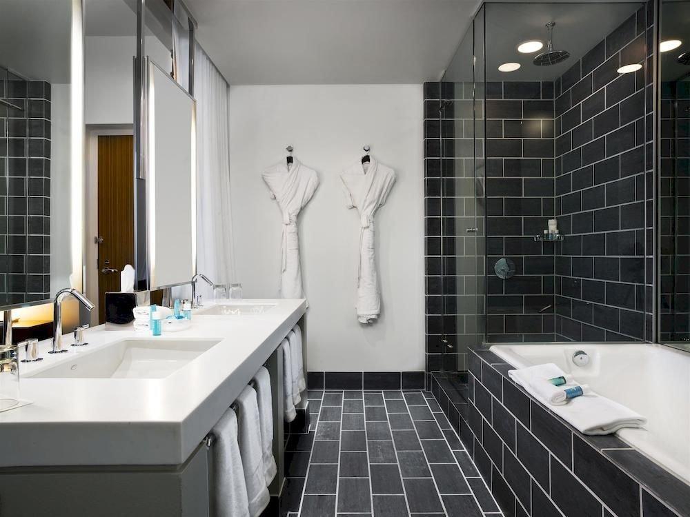 Bath City Modern bathroom sink toilet property bathtub white plumbing fixture flooring tiled Suite tile tub